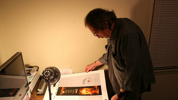 8_Fearworms creator Robert Payne Cabeen reviewing proof