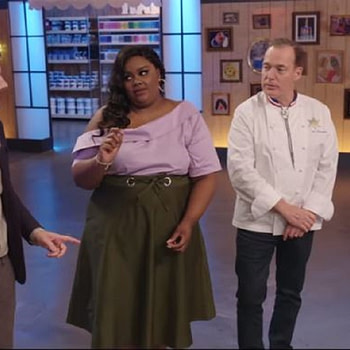 Host Nicole Byer, co-host Jacques Torres, and guest judge Adam Scott discuss their decisions on Nailed It, courtesy of Netflix.