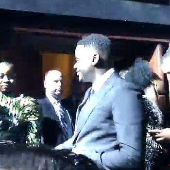 Daniel Kaluuyaand Letitia Wright dancing to man's Not Hot at Black Panther European premiere