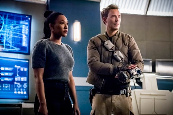 Candice Patton as Iris West - Allen and Tom Cavanagh as Nash Wells in The Flash, courtesy of The CW.