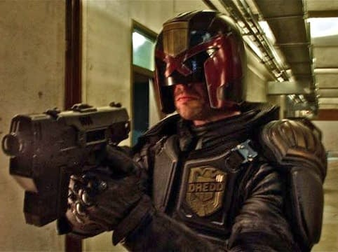 karl urban as judge dredd trains his lawgiver on you 2012