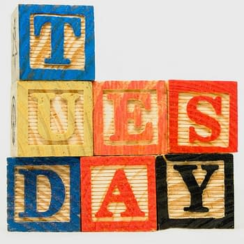 tuesday-text-on-wooden-blocks-on-white-background