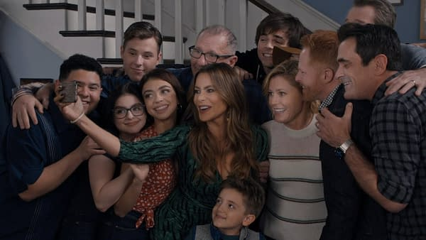 Phil, Mitch, Cam, Claire, Jay, Gloria, and the rest of the family gather for another group hug selfie on Modern Family, courtesy of ABC.