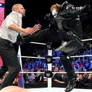 Sting takes on Triple H, courtesy of WWE (screencap).