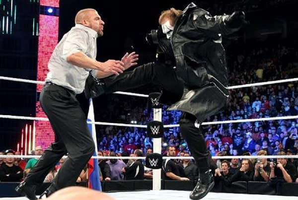 Sting takes on Triple H, courtesy of WWE (screencap).