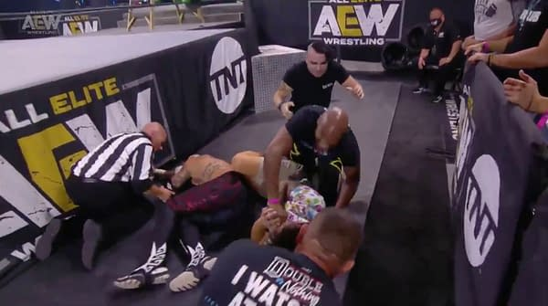 Rey Fenix hits a brutal dive on the floor... literally... on AEW Dynamite