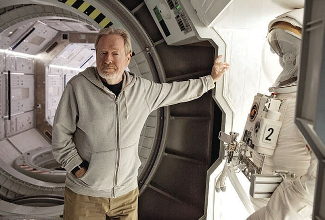 Ridley Scott poses on THE MARITAN set of the spaceship Hermes.