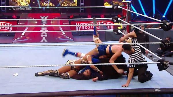Tamina is pinned by Bayley, Sasha Banks, Naomi, and Lacey Evans at WrestleMania 36.