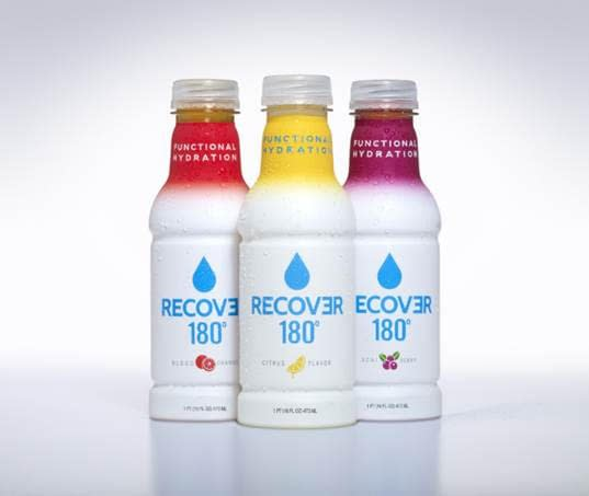 A couple of different bottles of RECOVƎR 180° flavors.