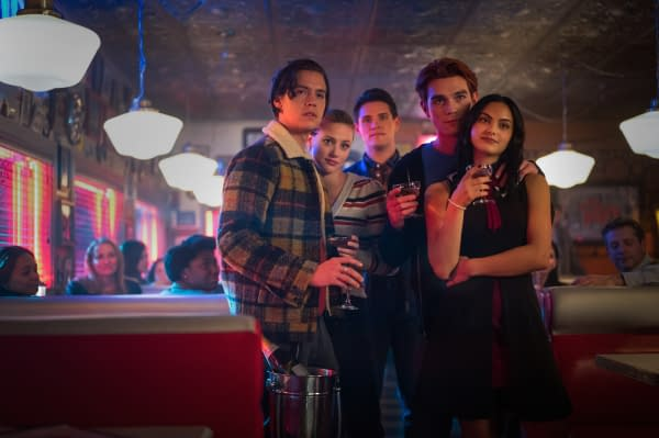 Cole Sprouse as Jughead Jones, Lili Reinhart as Betty Cooper, Casey Cott as Kevin Keller, KJ Apa as Archie Andrews, and Camila Mendes as Veronica Lodge on Riverdale, courtesy of The CW.