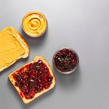Sandwiches or bread toast with peanut butter and fruit jelly. Flat lay. By Erhan Inga