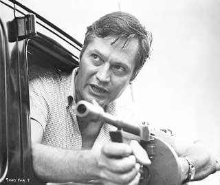roger corman with a gun