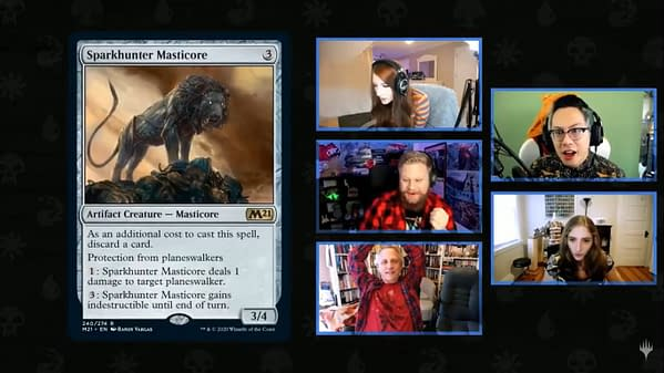 Sparkhunter Masticore, a new card from Core 2021, surprising many Magic: The Gathering streamers via webcam.