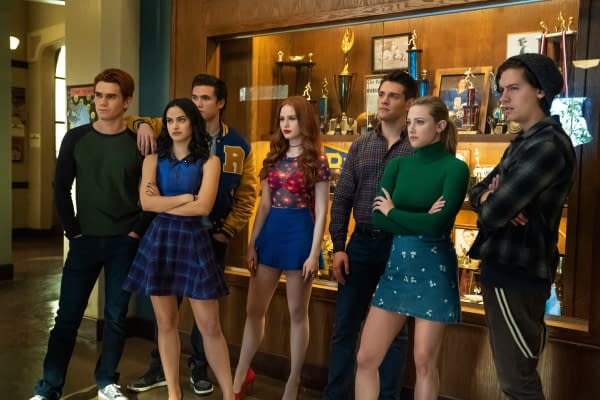 KJ Apa as Archie Andrews, Camila Mendes as Veronica Lodge, Charles Melton as Reggie Mantle, Madelaine Petsch as Cheryl Blossom, Casey Cott as Kevin Keller, Lili Reinhart as Betty Cooper, and Cole Sprouse as Jughead Jones in Riverdale, courtesy of The CW.