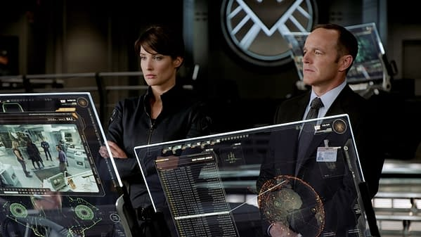 Maria Hill (Cobie Smulders) and Phil Coulson (Clark Gregg) in Marvel's The Avengers.