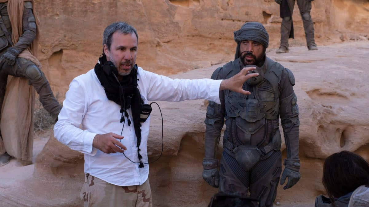 """Copyright: © 2020 Warner Bros. Entertainment Inc. All Rights Reserved. Photo Credit: Chiabella James Caption: (L-r) Director DENIS VILLENEUVE and JAVIER BARDEM on the set of Warner Bros. Pictures and Legendary Pictures' action adventure """"DUNE,"""" a Warner Bros. Pictures release."""