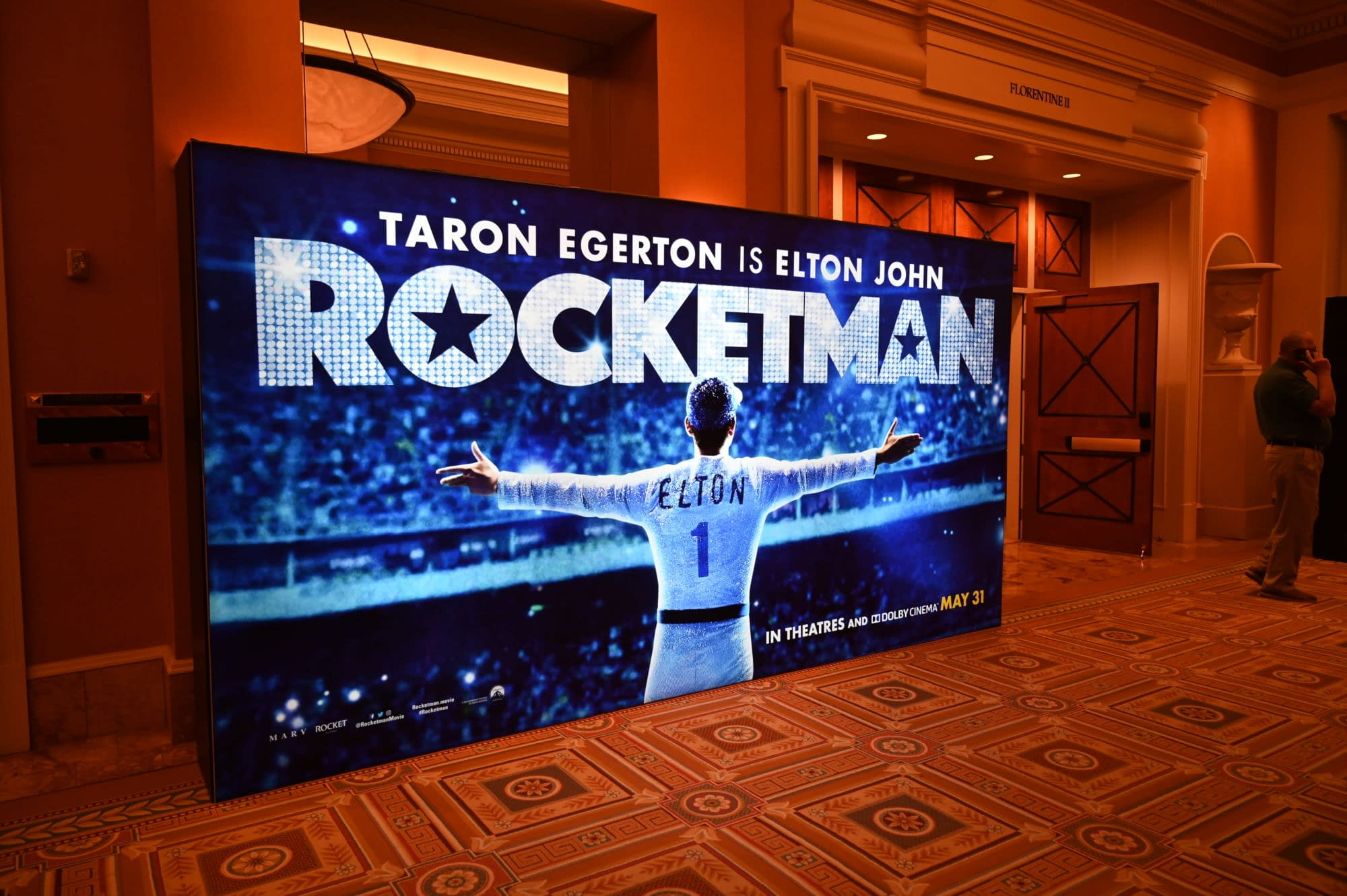 [CinemaCon 2019] Elton John Embraces the Crowd in a New Rocketman Standee