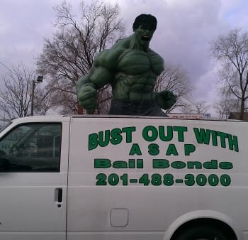 The Bail Bondsman With A Hulk Sticking Out Of The Top Of His Van