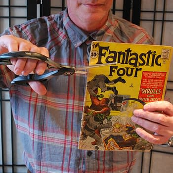Cutting Up A Copy Of Fantastic Four #2 With Scissors