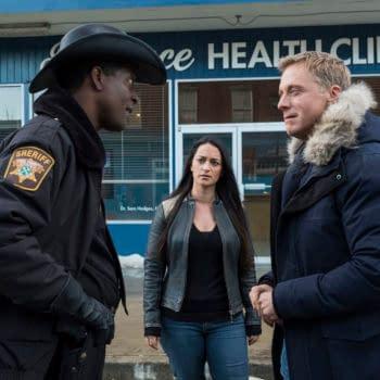 "RESIDENT ALIEN -- ""Pilot"" Episode 101 -- Pictured: (l-r) Corey Reynolds as Sheriff Mike Thompson, Sara Tomko as Asta Twelvetrees, Alan Tudyk as Harry Vanderspeigle -- (Photo by: James Dittinger/SYFY)"