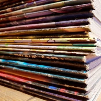 A stack of comic books from comic book publishers.