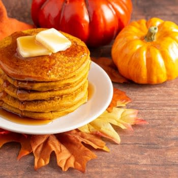 A Stack of Pumpkin Spice Flavored Pancakes on a Wooden Table. By P Maxwell Photography.