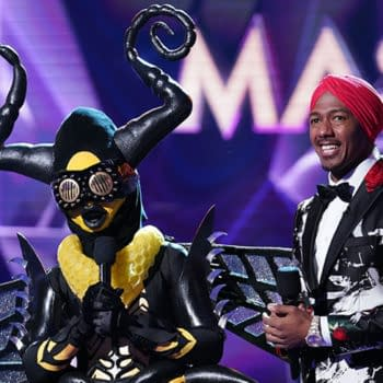 """THE MASKED SINGER: L-R: Bee and host Nick Cannon in the """"Semi Finals: Double Unmasking"""" episode of THE MASKED SINGER airing Wednesday, Feb. 20 (9:00-10:00 PM ET/PT) on FOX. © 2019 FOX Broadcasting. Cr. Michael Becker / FOX."""