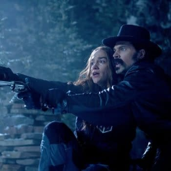 "WYNONNA EARP -- ""Afraid"" Episode 404 -- Pictured: (l-r) Melanie Scrofano as Wynonna Earp, Tim Rozon as Doc Holliday -- (Photo by: Michelle Faye/Wynonna Earp Productions, Inc./SYFY)"