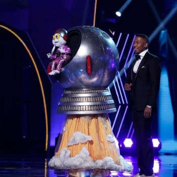 """THE MASKED SINGER: L-R: Baby Alien and host Nick Cannon in the """"The Group B Play Offs - Cloudy with a Chance of Clues"""" episode of THE MASKED SINGER airing Wednesday, Oct. 14 (8:00-9:00 PM ET/PT) on FOX. © 2020 FOX MEDIA LLC. CR: Michael Becker/FOX."""