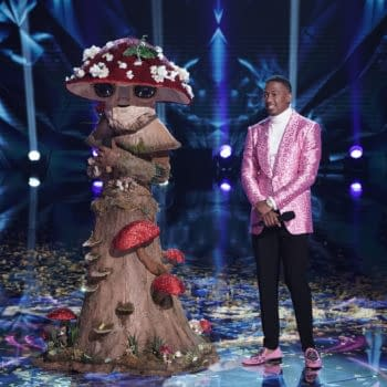 """THE MASKED SINGER: L-R: Mushroom with host Nick Cannon in the """"The Group C Play Offs - Funny you should Mask"""" episode of THE MASKED SINGER airing Wednesday, Nov. 4 (8:00-9:00 PM ET/PT) on FOX. © 2020 FOX MEDIA LLC. CR: Michael Becker/FOX."""