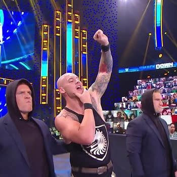 The Ratings King of Friday Nights, Baron Corbin, stands triumphant over The CW's stupid Christmas shows [WWE Smackdown Screencap]