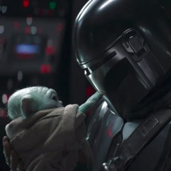 The Mandalorian and Grogu aka Baby Yoda from the second-season finale (Image: TWDC)