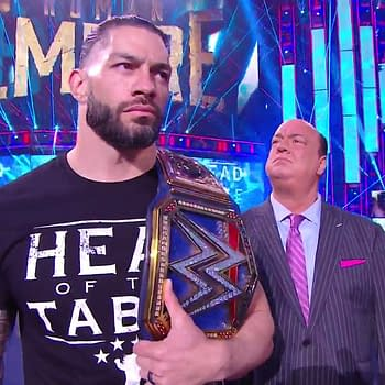 Roman Reigns and Paul Heyman head to the ring on WWE Smackdown.