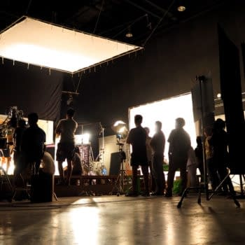 Behind the scenes of video shooting production crew team silhouette and camera equipment in studio. (Image: Shutterstock.com/Royalty-Free)