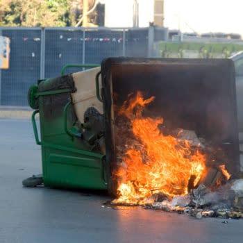 Fire in a Garbage Bin, photo credit: konstantinos69/shutterstock.com.