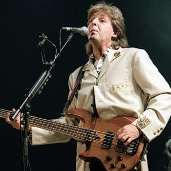 Washington DC. USA, 4th July, 1990 Paul McCartney performs at the Fourth of July concert in the Robert F. Kennedy football stadium. (Image: mark reinstein/Shutterstock.com)