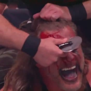Nick Gage slices up the forehead of Chris Jericho right before AEW Dynamite cuts to a commercial for Domino's Pizza.