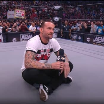 CM Punk sits in the middle of an AEW ring on his return to wrestling on AEW Rampage: The First Dance