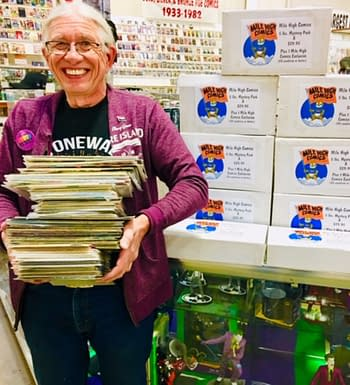 Chuck Rozanski stacking Mystery Boxes at Mile High Comics