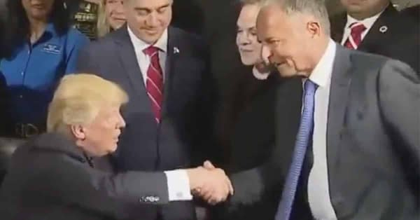 Donald Trump shakes hands with Marvel Chairman Ike Perlmutter