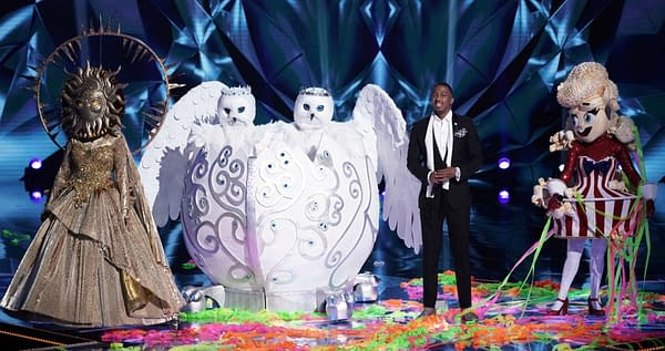 THE MASKED SINGER: L-R: Sun, The Snow Owls, host Nick Cannon and Popcorn in the