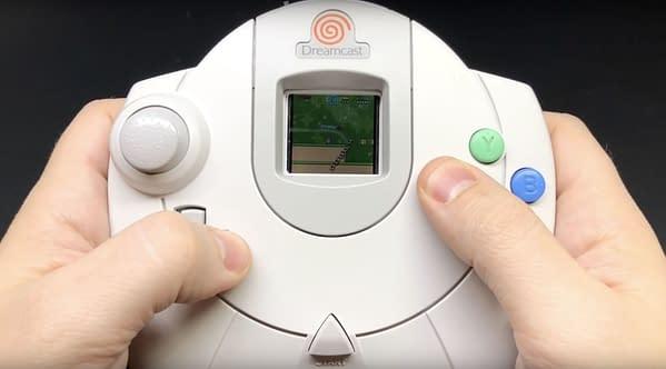 A man holding a Sega Dreamcast controller, courtesy of SEGA.