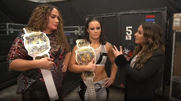 Nia Jax and Shayna Baszler celebrate after retaining the WWE Women's Championships against Sasha Banks and Bianca Belair at WrestleMania.