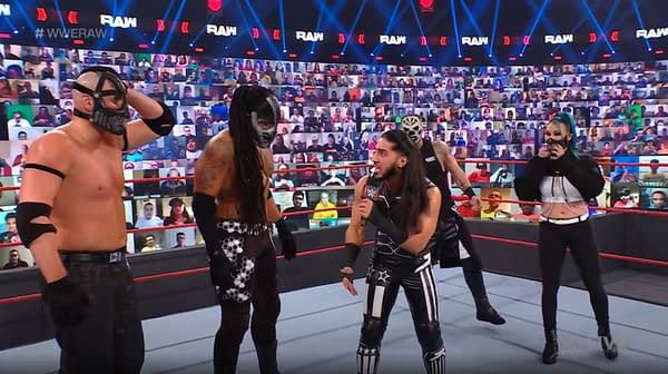 Mustafa Ali, a career jobber, ironically yells at his friends in Retribution who are also career jobbers for losing.