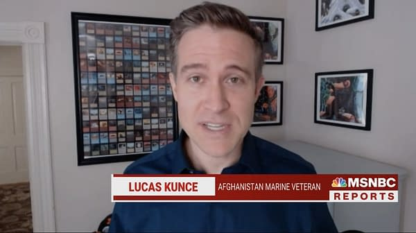 A shot of MO U.S. Senate candidate Lucas Kunce. In the background, an alleged uncut sheet of common Beta cards can be seen. (Image attributed to MSNBC)