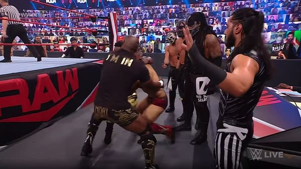 Showing just how far they have fallen, Retribution stands aside as Hurt Business, the physical manifestation of uncontrolled capitalism in WWE, upholds the corporate hegemony by tossing The Miz back into the ring with Bobby Lashley.