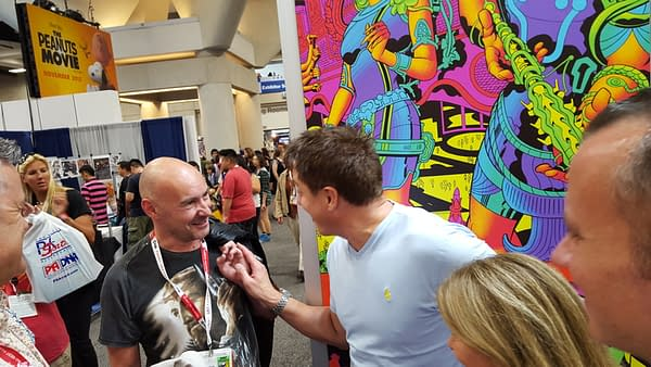 Editor-in-Chief Grant Morrison and John Barrowman at the Heavy Metal booth.