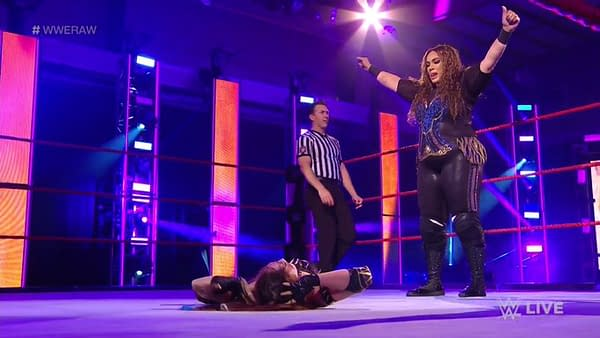 Nia Jax stands triumphant over Kairi Sane on WWE Monday Night Raw. [Broadcast/WWE]