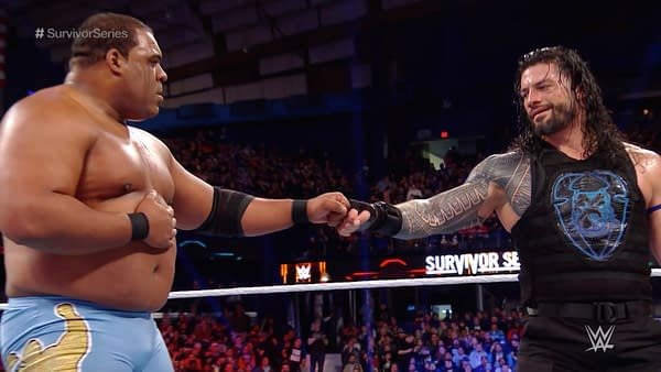 Roman Reigns and Keith Lee bump fists in a mutual show of respect after their WWE Survivor Series confrontation.
