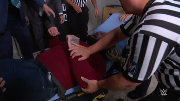 Bray Wyatt is loaded into an ambulance after an attack by Braun Strowman ahead of their SummerSlam match.